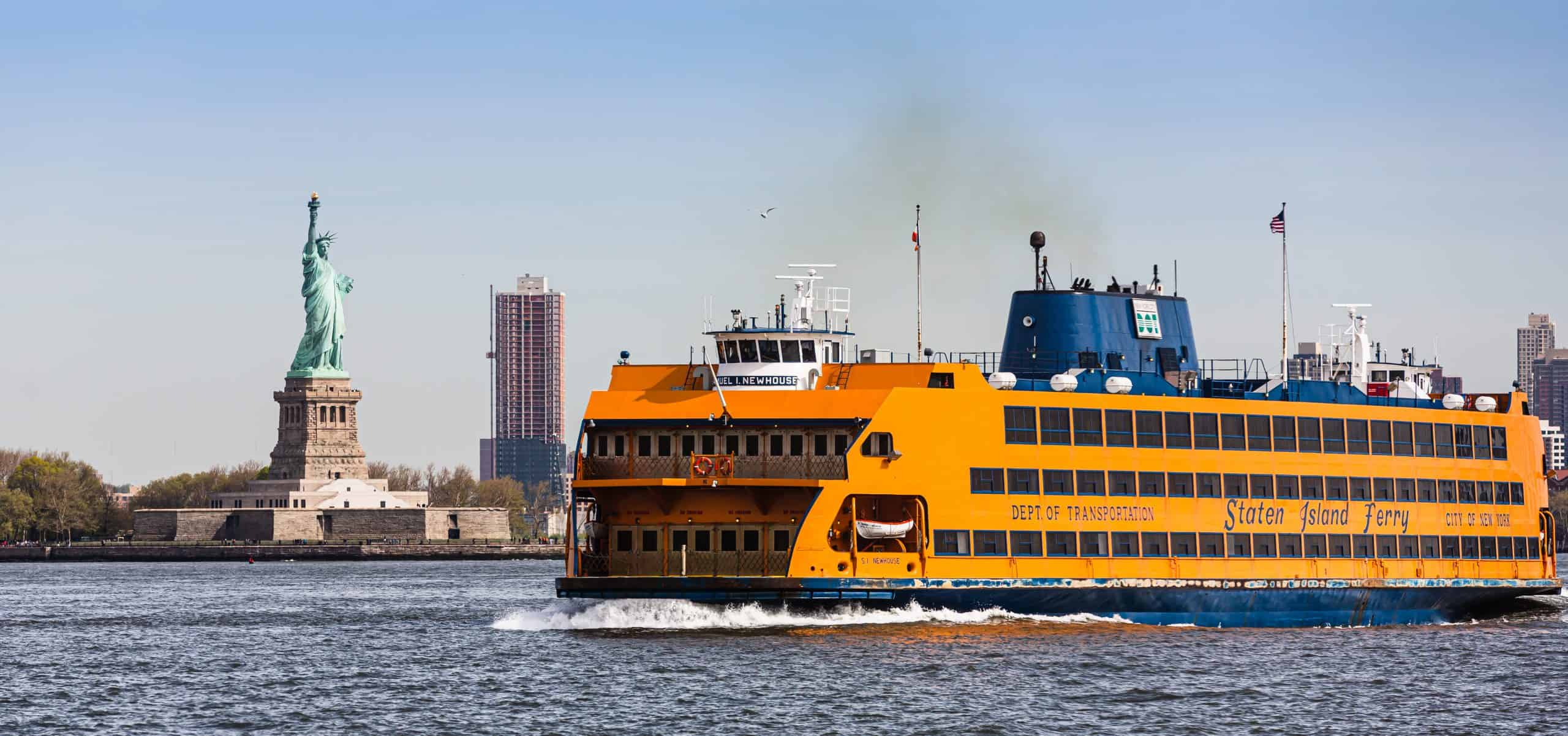 The Staten Island Ferry and the Statue of Liberty. what to do in new york city? Visitng the statue of Liberty is top things to do new york
