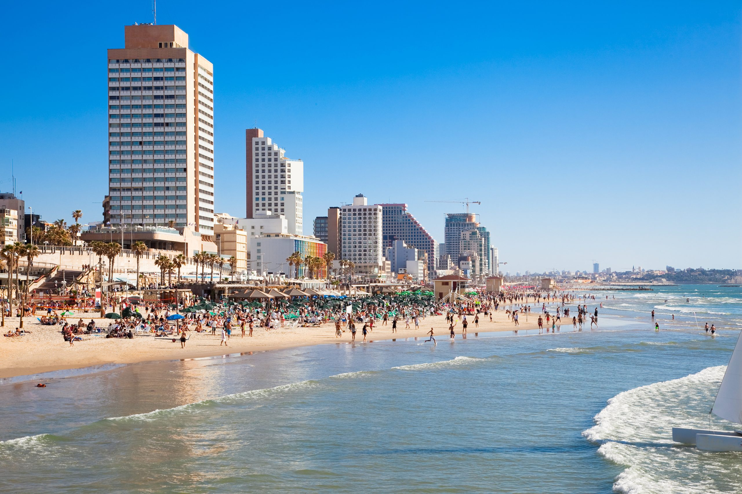 spending time on the beach is a must do in tel aviv. tel aviv beach. tel avivtel aviv