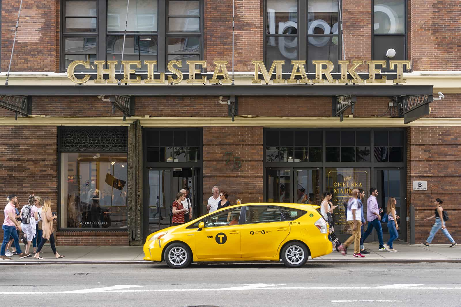 People visiting Chelsea Market in New York City. It is a food hall and shopping mall located in Manhattan.